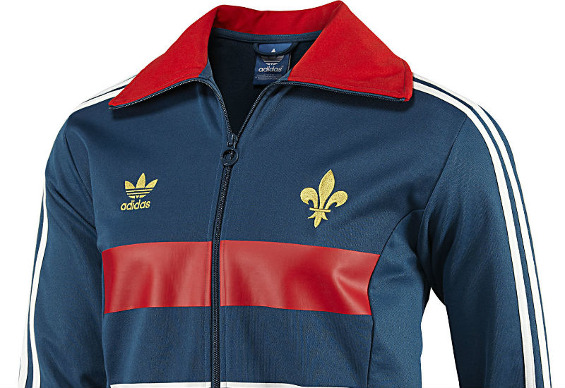 Vintage football style meets French team pride in the Adidas France Track Jacket.