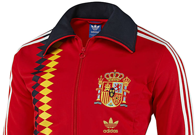 A regal jacket inspired by la Roja's iconic style, the Adidas Spain Track Jacket combines national colours with a Spanish Football Federation badge on the chest.